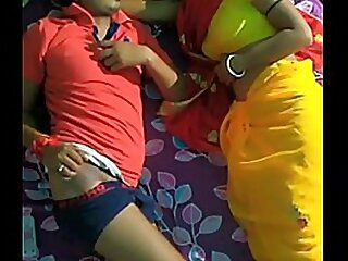 indian couple has conversation in bed